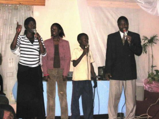db_Pastor_George_and_his_family_sing_a_song_for_us_1491